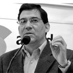 Photo of Raul Panaranda speaking into microphone