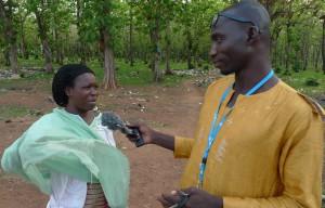Yussif interviews a woman outside